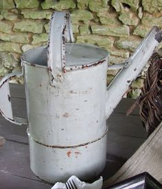 Charming old watering can