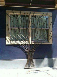 Reja para ventana forma.de arbol