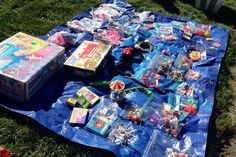 This is a great example of using a tarp to display things on the lawn at your yard sale. Notice how the blue tarp makes the individual items much more noticeable - because the colors and shapes really 'pop'. photo by jeepersmedia on Flickr