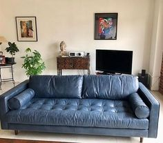 Article sofa Sven in blue leather.