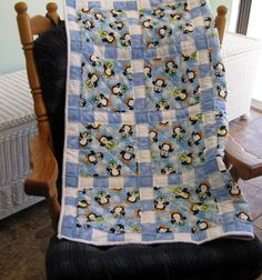 Chilly Penguin Blues a handmade baby quilt designed by The Baby Quilt Lady. http://shop.uniquebabyquiltboutique.com/main.sc