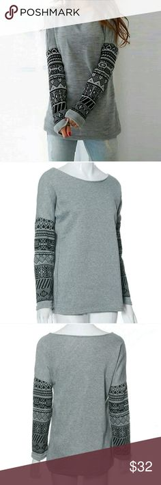 Round Neck Long Sleeve Top Round Neck Long Sleeve Pullover Top with Tribal Sleeves.   *** THIS IS NOT A SWEATSHIRT IT IS A LONG SLEEVE TEE ***  These are NWOT Retail Price Firm Unless Bundled. Measurements Available Upon Request. Tops Tees - Long Sleeve