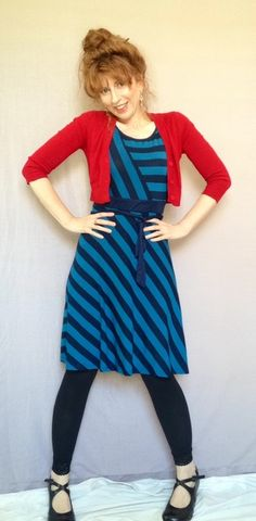You've unexpectedly found yourself with a bright, breezy afternoon that's plan-free. Who better to spend the day with in a sweetly striped dress than your lovely self? Do the things you love most while staying comfortable in this cotton-blend dress' diagonal lines across the mid-length skirt. Half the short-sleeve bodice boasts alternating lake- and navy-blue horizontal stripes that meet matching oblique bands in the middle. Browse for bouquets, catch a matinee, or lounge i...