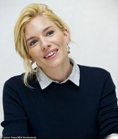 Minimalist: Sienna Miller looked exquisite in minimal make-up as she answered questions on the fi...