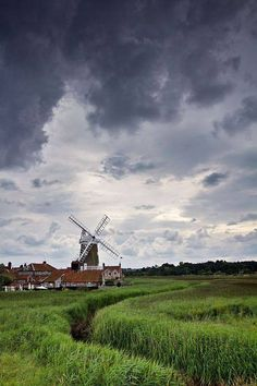 England Travel Inspiration - Moody Skies over Cley Windmill, Norfolk, UK The Norfolk Broads are a network of navigable rivers and lakes in the counties of Norfolk and Suffolk Norfolk Broads, Norfolk Coast, Norfolk England, England Uk, Great Places, Places To See, Beautiful Places, Peaceful Places, British Countryside
