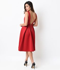 red midi dress with a nipped in waist and low back. this would be perfect for holiday parties!
