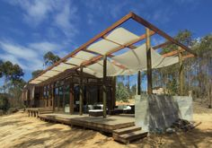 Built by CO2 Arquitectos in Algarrobo, Chile, Chile with date 2013. Images by Productora AndesEmpire  . The House of Tunquén is situated at an intermediate level that occurs at a terrain with a slight slope facing the Nor...
