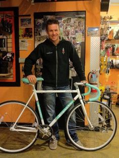 Felix Baumgartner with his Bianchi Pista. what a hottie, space suit or street clothes.