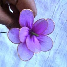 Make flowers from old tights - Follow @Guidecentral for #DIY and #craft ideas