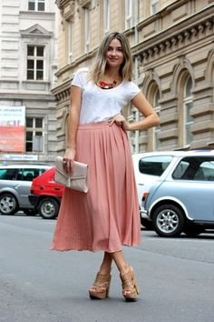 Coral maxi skirt and a white tee. Very simple and chic.