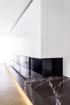 berlin - penthouse - living area - dining area - dining area - built-in - herringbone - oak - floor - walnut-panell - elevator core - fireplace - marble - grey - black - white - wohnung - wohnbereich - kamin - marmor - schwarz - weiß - fischgräte - eiche