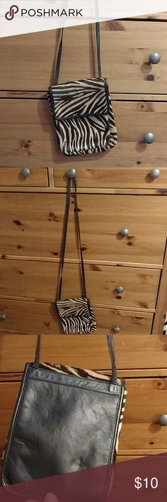 Zebra print cross body purse Very gently used-- one of the straps came loose so I reinforced it (last photo) Bags Crossbody Bags