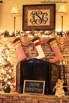 monogram over mantle with beautiful Christmas decorations and stockings
