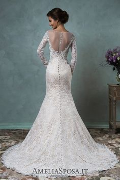 Wedding dress Tiffany - AmeliaSposa.    A stunning design that puts an accent on a bride's forms. A top laced dress with transparent elements embroidered with beads and Swarovski crystals lets you forget about jewelry pieces and draws attention to sexual body lines.