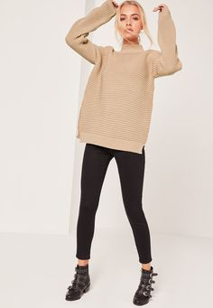 Be effortlessly prepared for the 'ber months in this ribbed jumper - featuring a camel hue, funnel neck and stitch deets.