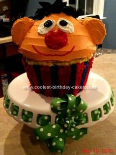 Homemade Ernie Cupcake Cake Pan Cake: My son LOVES Ernie, and it is hard to find Ernie items especially ones that don't include his side-kick, Bert.  And I don't like flat sheet cakes, go big