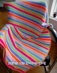 It's a very easy pattern, three rows granny stripes and than one row double crochet (U.S.), and keep repeating. http://www.pinterest.com/pin/126734176984615296/