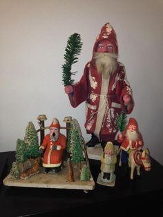 Collection of antique Santas.