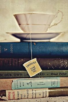 Tea in one hand, a book in the other.
