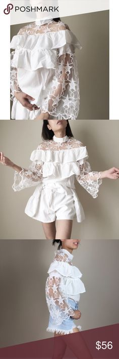 """Sonia Ruffle top with stars appliqués. White chiffon like top with stars appliqué. Two tier ruffle with button top (back).flare sleeve with starry appliqués  front and back. High fashion statement piece .top quality polyblend and appliqués.size S. Limited stock only.  Bust 34"""", length20"""" .. long flare sleeve19"""". Short pants on cover shot not included. Only for styling.👉🏼Follow me on  📸INSTAGRAM: @chic_bomb  and 💁🏻📘FACEBOOK: @thechicbomb CHICBOMB Tops Blouses"""