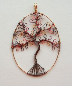 wire-wrapped l eafy tree of life pendant.