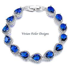 SAPPHIRE Bridal Bracelet BLUE Wedding Bracelet Tear Drop CZ Bling Prom Wedding Jewellery Mother of the Bride Maid of Honor  Sapphire Blue AAA+ Swiss Cubic Zirconia teardrop bridal bracelet made with environmental copper, luster rhodium plated and Sapphire Blue Swiss CZ teardrop stones. This is a classic, elegant and expensive looking bracelet! These fancy teardrop stones are highly detailed and fully paved for an extra sparkle and sophistication! Perfect for weddings and special occasions…