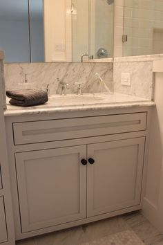 beautiful small marble bath - one with a shower, and one with a tub.