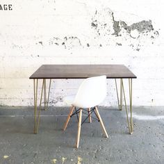 Minimalist-Industrial Solid Walnut and Golden Hairpin Legs dining table.  Your choice of solid WOOD:  -Black Walnut; -White Oak; -Reclaimed barn wood.  Your choice of LEGS COLOR (powder coat):  -White; -Mat Black; -Golden; -Raw Steel.  TABLE: 48 long x 28 deep x 29 tall  DESK: 48 long x 24 deep x 29 tall  (Contact us for different dimensions!)   For our GROGG Hairpin STOOLS, check out: https://www.etsy.com/ca/listing/278414916/small-grogg-stool-for-kids-with-hairpin?ref=shop_home_active_13