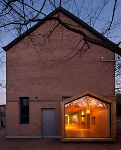A house-shaped extension protrudes from the side of this children's centre