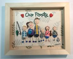 Our Family painted pebble art. A family who loves the outdoors, sports, fishing and music.