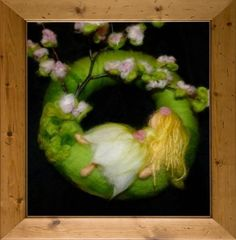 Springtime in fairies garden.  A little fairy is dreaming under the flowered apple tree in the fairies garden...  The ring has 22 cm.  This is made from wool, nature material, styropor ring.  Really pretty.