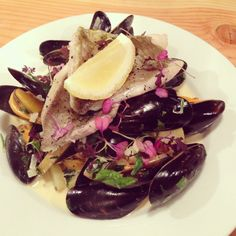 San Pietro John Dory fillets served with mussels and potatoes in a creamed white wine sauce.
