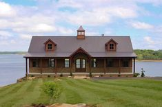 metal barn homes A covered porch spans the full length of this home plan designed on a walkout basement. Two dormers add balance to the exterior and a cupola adds a nice inside Pole Barn House Plans, Lake House Plans, Basement House Plans, Country House Plans, Small House Plans, House Floor Plans, Walkout Basement, Country Homes, Metal House Plans
