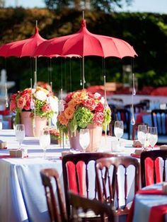Tuck an umbrella into each vase for a burst of color at an outdoor wedding reception or even a bridal shower! Find umbrellas for rent and/or sale at splendorforyourguests.com! Splendor for Your Guests | Rental Company | Weddings | Events | Shawls | Blankets | Umbrellas | Parasols | Fans