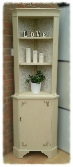 Corner cabinet in Annie Sloan Old Ochre chalk paint with wallpaper decoupage. www.facebook.com/uniquenchicinteriors