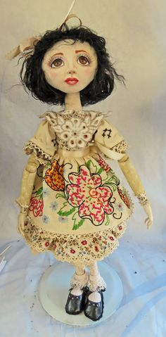Young Frida dressed in vintage splendor.  Her apron is a tea towel hand embroidered.  It was quite stained so I soaked it in coffee and everything now blends!  Also soaked the dress fabric, and arm and leg fabric in coffee too.  Her colar is the corner of a tea towel.  The lace is vintage also stained but matches perfectly!  Made as a gift for a dear friend.