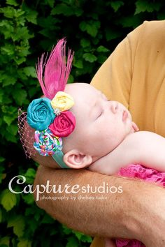 rosette feather headband - I would definitely do this with my own color scheme, but a fascinator for Emmy on Derby Day would be amazing!