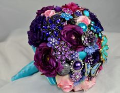 Brooch bouquet that combines brooches with real/silk flowers. Also, for a shower, ask guests to bring a brooch for you to include in bouquet - genius! Purple Wedding, Wedding Flowers, Dream Wedding, Perfect Wedding, Wedding Colors, Fake Flowers, Silk Flowers, Plastic Flowers, Wedding Brooch Bouquets
