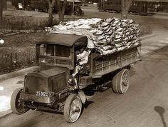 Truck load of beef being delivered to Central Market, Washington, D.C.; black driver