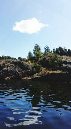 rock - object, tranquility, nature, water, waterfront, tranquil scene, beauty in nature, sky, day, scenics, no people, outdoors, tree