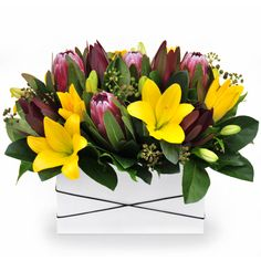 Sunny Coast - a deluxe trough arrangement of long-lasting Australian natives and vibrant tiger lilies.