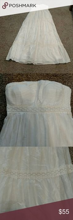 NWOT: White Jessica Simpson strapless maxi: M New without tags. Took them off when I bought it & never wore it. Gorgeous white strapless full length maxi dress. Lace detailing on bottom & top. Material on top to hold dress up. Full length white slip underneath. Ties in the back. This dress could be worn as formal or casual. Perfect condition!! No rips or stains!! Offers welcome!! Jessica Simpson Dresses Maxi