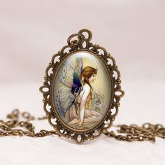 Vintage Fairy Illustration Oval Glass Pendant Necklace in Bronze with free chain ODB1 by prideandpendants on Etsy