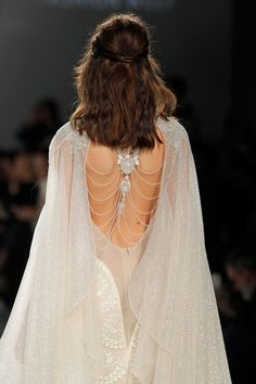 """Gorgeous beaded back design on this sexy wedding gown // In our second feature on our favourite designers at Barcelona Bridal Fashion Week 2017 which we covered as an Official Media partner, we fix our gazes on Galia Lahav's bohemian Gala No. IV line and dramatic Victorian Affinity 2018 collection. The standout pieces for us on the catwalk? """"Thelma"""", a homage to Queen Victoria's wedding gown with sheer drape silk tulle sleeves and """"Liliya"""", a fairytale ball gown made of real silver twilight…"""