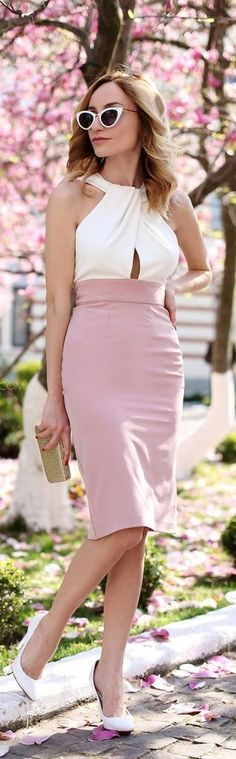 Pink skirt, white top, white high heel shoes