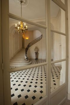 Apartment Foyer - there's nothing more romantic and inviting than a beautiful entrance with a staircase. #MyFrenchLoveStory