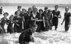 These bathers enjoying the waves at Ocean Park, Maine in August of 1906 wear a variety of bathing costumes, all of which clung to the body when wet.