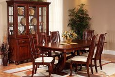 The Amish Home - Upstate Dining Room Suite:  Shown in solid cherry; also available in oak or brown maple.  This table is available with two or four leaves.  Cabinet collection features two- and three -door sizes.  Choose from over 50 chair styles.