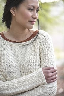 Gansey-inspired stitch patterns traverse this knitted pullover from designer Jesie Ostermiller. Knit in the round from the bottom up, this sweater features asymmetrical bottom hems and raglan sleeve shaping.