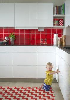 white kitchen red square tile back splash red/white zig zag rug